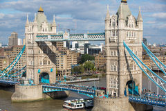 LONDON, Tower bridge and lots of walking people on south bank Royalty Free Stock Images