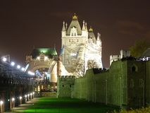 London - Tower bridge by night. Tower Bridge and Tower of London wall, by night Stock Image