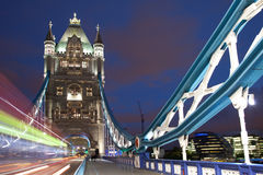 London Tower Bridge at night. With a bus passing by Stock Photo