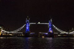 London Tower bridge at night. LONDON, UNITED KINGDOM - SEPTEMBER 11 2015: London Tower bridge at night by the river Thames, lighted in Blue Royalty Free Stock Photo
