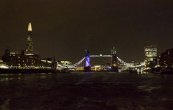 London Tower bridge at night. LONDON, UNITED KINGDOM - SEPTEMBER 11 2015: London Tower bridge at night by the river Thames, lighted in Blue Royalty Free Stock Images