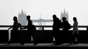 London Tower Bridge rush hour commuters stock video footage