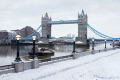 London tower bridge with snow. London tower bridge by river thames with snow royalty free stock image