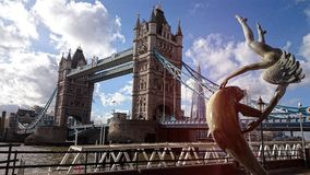 London tower bridge with statue royalty free stock image