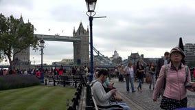 London Tower Bridge, Tourists People Walking along Thames River in Sunset 4K