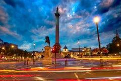 London-Trafalgar-Platz-Sonnenuntergang Nelson-Spalte Stockfotos