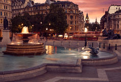 London Trafalgar Square fountain at sunset Stock Photo
