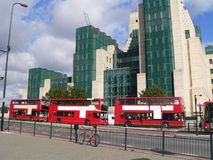London Traffic. During my last visit of London in October 2005 i was fascinated of the parallelism of the green houses and the red busses together with the red royalty free stock images