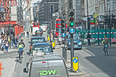 London traffic, buses, bikes, taxis and cyclists. Traffic in Oxford Street London comprising  vans, taxis, buses and cyclists nose to tail with construction Royalty Free Stock Images