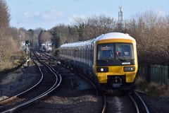 A London train. Train approaching a London station on a winters afternoon Royalty Free Stock Photography
