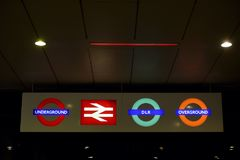 London Transport four illuminated signs. Illuminated signs showing the different means of transport in London Royalty Free Stock Images