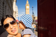 London travel Mother and Baby tourist by Big Ben and Red Telephone Booth Royalty Free Stock Photo