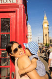 London travel Mother and Baby tourist by Big Ben and Red Telephone Booth Stock Photography
