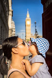 London travel Mother and Baby tourist by Big Ben Stock Photos