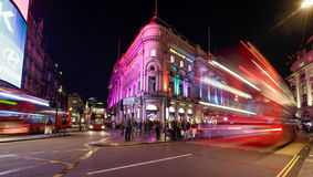 London Trocadero and Traffic at Night. LONDON - SEPTEMBER 19 : Motion blurred traffic and people passing the Trocadero in Piccadilly Circus, London on 19th Royalty Free Stock Image