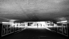 London tube. The dark London tube with walkers silhouettes Royalty Free Stock Images