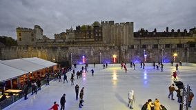 London Twilight ice skating scene in the ice rink. London Twilight ice skating scene on the ice rink at Tower of London stock footage