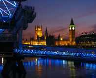 London Twilight, UK. Twilight view of London (United Kingdoms) skyline with a focus on the House of Parliament (Palace of Westminster), seen from under the stock photo