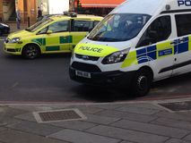 Police van and car in Lewisham. Police van and police car on scene at Lewisham High Street Royalty Free Stock Photo