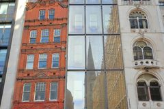 Colorful facades of buildings on Fenchurch Street in the financial district of the City of London with  reflections of Saint Marga. LONDON, UK – FEBRUARY 25 Royalty Free Stock Photo