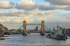 Tower Bridge and HMS Belfast. LONDON, UK – JAN 2018: View of Tower Bridge and HMS Belfast from London Bridge on a sunny winter day Stock Photos