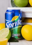 LONDON, UK - APRIL 12, 2017: Aluminium can of Sprite drink on wooden background with lemons and limes. Sprite is lemon-like flavor. Ed soft drink produced by royalty free stock images
