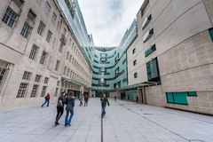 LONDON, UK - APRIL 9, 2013: BBC head office and square in frond of main entrance with people Royalty Free Stock Photography