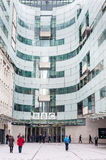 LONDON, UK - APRIL 9, 2013: BBC head office and square in frond of main entrance with people Royalty Free Stock Photo