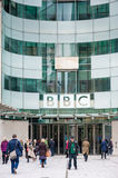 LONDON, UK - APRIL 9, 2013: BBC head office and square in frond of main entrance with people Stock Images
