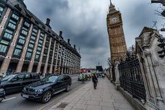 LONDON, UK - APRIL 9, 2013: Big Ben and Bridge street with tourists and cars Stock Image