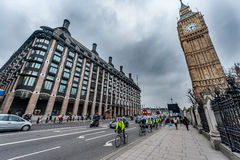 LONDON, UK - APRIL 9, 2013: Big Ben and Bridge street with tourists and cars Royalty Free Stock Photography