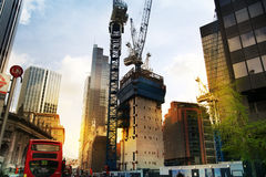 LONDON, UK - APRIL 24, 2014: Building site with cranes in the City of London one of the leading centres of global finance. Royalty Free Stock Image