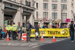 London, UK - April 15, 2019: Extinction Rebellion campaigners barricade at Oxford Circus, The campaigners blocked Oxford Circus,. Marble Arch, Piccadilly Circus stock photos