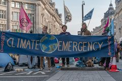 London, UK - April 15, 2019: Extinction Rebellion campaigners barricade at Oxford Circus, The campaigners blocked Oxford Circus, royalty free stock photo