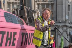 London, UK - April 15, 2019: Extinction Rebellion campaigners spokesman gave speech on a a pink boat in blocked Oxford Circus royalty free stock image