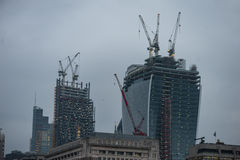 LONDON, UK - APRIL 9, 2013: London Business District Onder Construction. Cranes on the roofs. Late evening photo shoot Stock Photography
