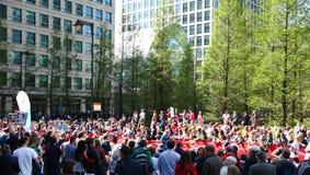 LONDON, UK - APRIL 13, 2014 - London Marathon in Canary Wharf aria, massive sport event for professionals and amateurs sportsmen,. LONDON, UK - APRIL 13, 2014 Stock Images