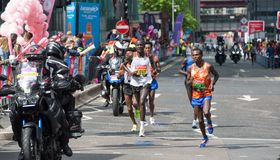 Professional sprinter arriving the first in Canary Wharf.. London, UK. London, UK - April 23, 2017: London Marathon. Professional sprinter arriving the first in Stock Photography