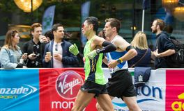 Professional sprinter arriving the first in Canary Wharf.. London, UK. London, UK - April 23, 2017: London Marathon. Professional sprinter arriving the first in Royalty Free Stock Photography