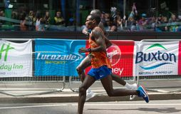 Professional sprinter arriving the first in Canary Wharf.. London, UK. London, UK - April 23, 2017: London Marathon. Professional sprinter arriving the first in Royalty Free Stock Photos