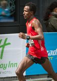 Professional sprinter arriving the first in Canary Wharf.. London, UK. London, UK - April 23, 2017: London Marathon. Professional sprinter arriving the first in Royalty Free Stock Photo