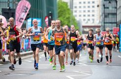 Lots of people running in London Marathon. London, UK Royalty Free Stock Images