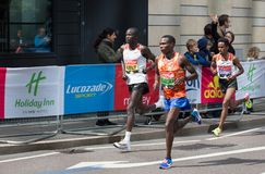 Professional sprinter arriving the first in Canary Wharf.. London, UK. London, UK - April 23, 2017: London Marathon. Professional sprinter arriving the first in Stock Images