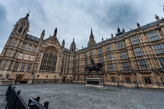 LONDON, UK - APRIL 9, 2013: One Side of British Parliament Architecture Monument with Horse Statue. Wide Angle Photo Shoot. Stock Images
