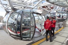 Passenger capsule arriving at boarding platform of the London Eye in London, England. London, UK - April 2018: Ovoidal passenger capsule arriving at boarding Royalty Free Stock Photography
