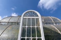 Palm House, an iconic Victorian glasshouse that recreates a rainforest climate located at Kew Garden, England. London, UK - April 2018: Palm House, an iconic Royalty Free Stock Images