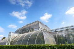 Palm House, an iconic Victorian glasshouse that recreates a rainforest climate located at Kew Garden, England. London, UK - April 2018: Palm House, an iconic Stock Photography