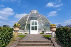Palm House, an iconic Victorian glasshouse that recreates a rainforest climate located at Kew Garden, England. London, UK - April 2018: Palm House, an iconic Stock Image