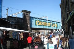 London, UK - April 01, 2012: people walk in the street past the Camden Market stalls. royalty free stock photography