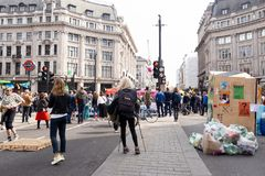 London - April 18 2019:- Protesters block the road in central London to protest the current environmental emergency. stock photography